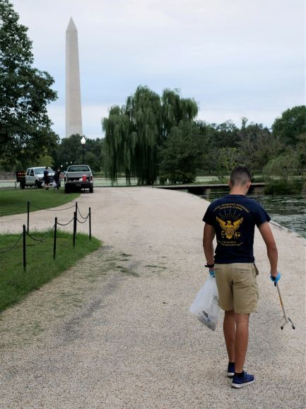 NROTC Midshipman cleaning up the National Mall